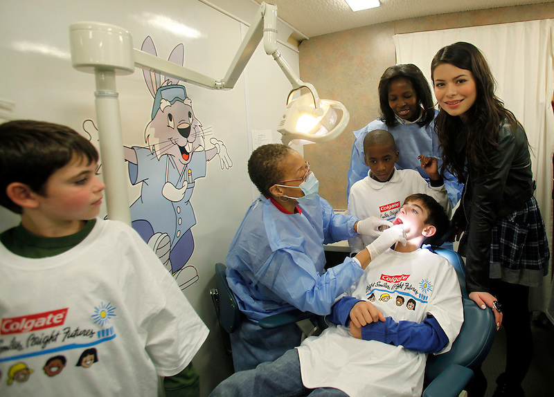 """Actress and musician Miranda Cosgrove  (R) attends a Colgate event, """"100 million smiles Celebration"""" in New York October 27, 2009. Natalie Behring / AP for Colgate-Palmolive Company"""
