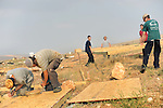 Settler youth during reconstruction works in the unauthorized Israeli outpost of Ma'oz Ester, West Bank. The outpost was demolished a week earlier, following Israeli government decision to remove unauthorized outposts in the West Bank.