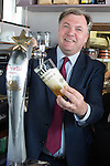 © Joel Goodman - 07973 332324 . 11/04/2015 . Bury , UK . Labour Shadow Chancellor ED BALLS pours a pint . Ed Balls and James Frith , Labour candidate for Bury North , at a campaign stop at Barista coffee shop at The Rock , Bury in Greater Manchester , UK . The pair met parents and discussed family finances . Photo credit : Joel Goodman