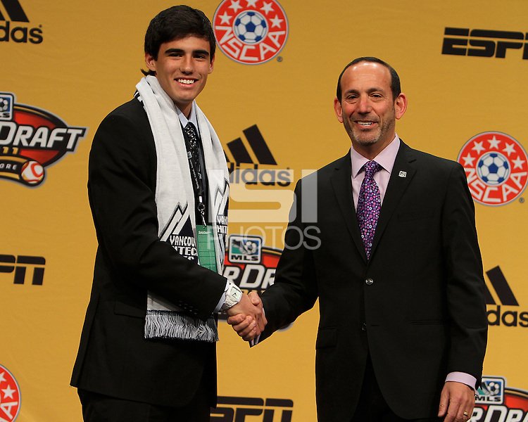 Omar Salgado first pick of the Vancouver Whitecaps with commissioner Don Garber at the 2011 MLS Superdraft, in Baltimore, Maryland on January 13, 2010.