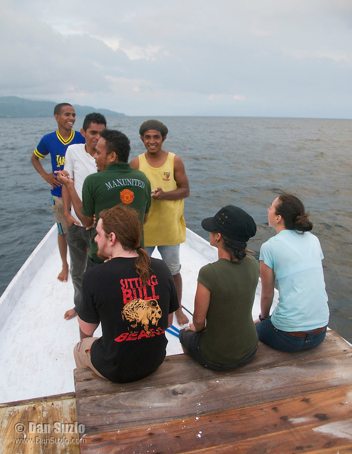 American and Timorese students on the deck of a boat crossing the Wetar Strait from Dili to Atauro Island, Timor-Leste (East Timor). Seated, l to r: Scott Heacox, Marianna Tucci, Caitlin Sanchez. Standing: Unidentified Timorese crewmember, Zito Afranio, Luis Lemos, Laca Ribeiro.