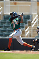 Thomas Jones (12) of the Greensboro Grasshoppers follows through on his swing against the Kannapolis Intimidators at Kannapolis Intimidators Stadium on August 5, 2018 in Kannapolis, North Carolina. The Grasshoppers defeated the Intimidators 2-1 in game one of a double-header.  (Brian Westerholt/Four Seam Images)