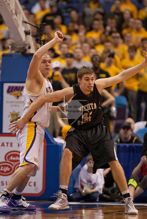 March 7,  2010           Wichita State center Garrett Stutz (41) and Northern Iowa center Jordan Eglseder (53, left) jostle for position under the basket in the second half.  Both were named to the All-Tournament Team.  The University of Northern Iowa defeated Wichita State 67-52 on Sunday March 7, 2010 in the championship game of the Missouri Valley Conference Tournament at the Scottrade Center in downtown St. Louis.   They automatically earn a berth in the NCAA Tournament.
