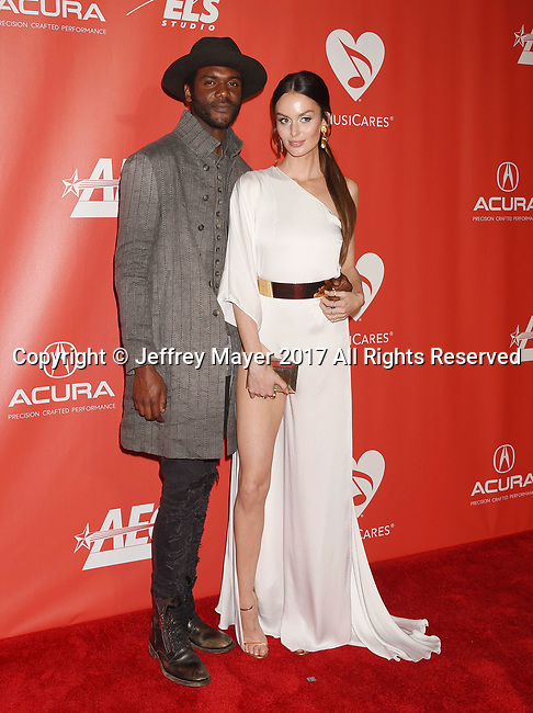 LOS ANGELES, CA - FEBRUARY 10: Musician Gary Clark Jr. (L) and wife-model Nicole Trunfio attend MusiCares Person of the Year honoring Tom Petty at the Los Angeles Convention Center on February 10, 2017 in Los Angeles, California.
