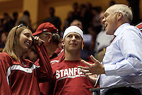 BERKELEY, CA - MARCH 30: Stanford University president John Hennessey chats with Stanford fans during Stanford's 74-53 win against the Iowa State Cyclones on March 30, 2009 at Haas Pavilion in Berkeley, California.