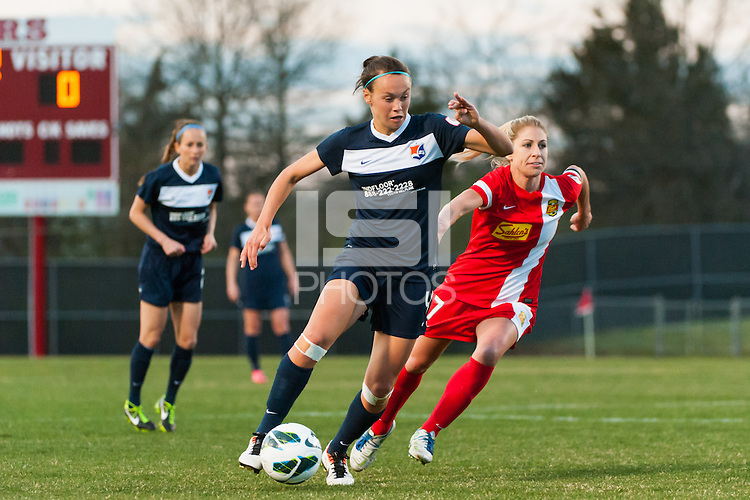 Sky Blue FC defender Caitlin Foord (4) is marked by Western New York Flash midfielder McCall Zerboni (7). Sky Blue FC defeated the Western New York Flash 1-0 during a National Women's Soccer League (NWSL) match at Yurcak Field in Piscataway, NJ, on April 14, 2013.