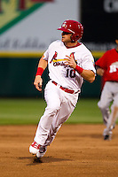 Aaron Luna (10) of the Springfield Cardinals hurries to third base during a game against Frisco RoughRiders on April 14, 2011 at Hammons Field in Springfield, Missouri.  Photo By David Welker/Four Seam Images.