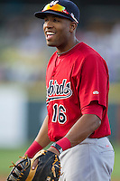 Memphis Redbirds first baseman Xavier Scruggs #16 smiles during the Pacific Coast League baseball game against the Round Rock Express on April 24, 2014 at the Dell Diamond in Round Rock, Texas. The Express defeated the Redbirds 6-2. (Andrew Woolley/Four Seam Images)