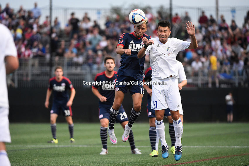June 17, 2015 - Boston, Massachusetts, U.S. - New England Revolution forward Diego Fagundez (14) heads the ball while being defended by Charlotte Independence midfielder Carlos Alvarez (57) during the US Open Cup fourth round between the New England Revolution and the Charlotte Independence held at Harvard's Soldiers Field Soccer Stadium. The Independence defeated the Revolution 1-0.  Eric Canha/CSM