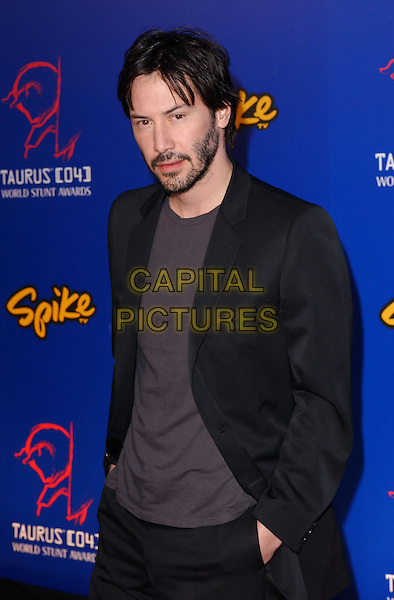 KEANU REEVES.The 4th Annual Taurus World Stunt Awards held at The Paramount Picture Studios in Los Angeles California .May 16,2004.half length, half-length, black suit, hands in pockets, beard, facial hair.www.capitalpictures.com.sales@capitalpictures.com.©Capital Pictures