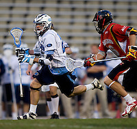 Cam Wood (21) of North Carolina is defended by Dean Hart (16) of Maryland during the ACC men's lacrosse tournament semifinals in College Park, MD.  Maryland defeated North Carolina, 13-5.