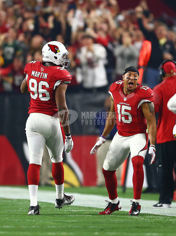 Jan 16, 2016; Glendale, AZ, USA; Arizona Cardinals wide receiver Michael Floyd (15) reacts alongside linebacker Kareem Martin (96) against the Green Bay Packers during an NFC Divisional round playoff game at University of Phoenix Stadium. Mandatory Credit: Mark J. Rebilas-USA TODAY Sports