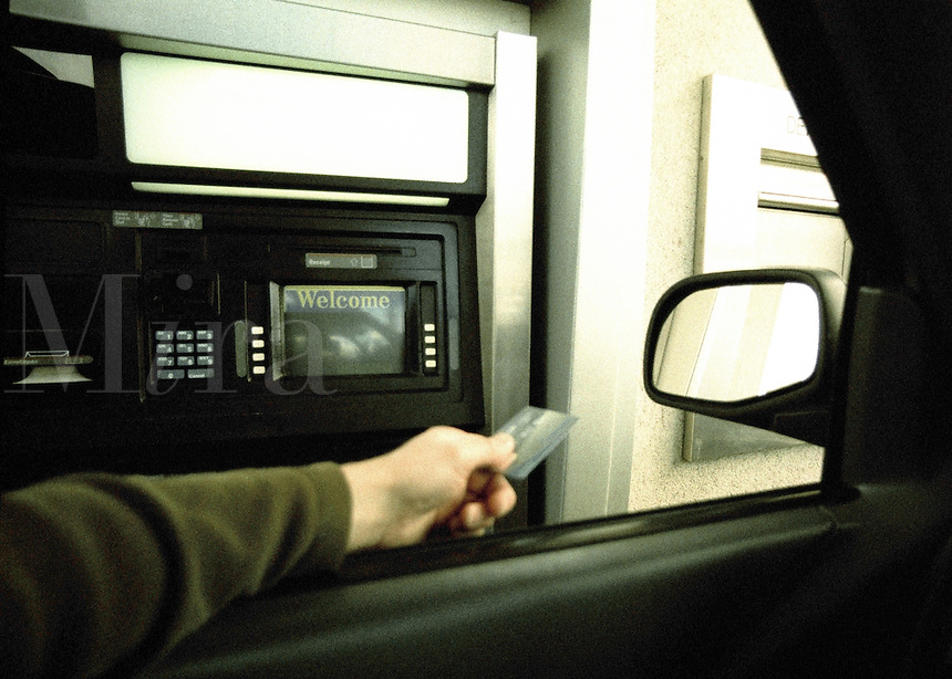 Man at drive up ATM / automatic teller machine