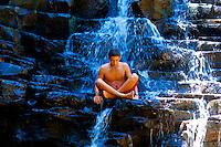 A teenager enjoying the waterfall at Twin Falls, Haiku, Maui