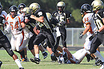 Palos Verdes, CA 09/22/11 - unknown Beverly Hills player(s) and Jordan Gates (Peninsula #9) and Noah Stettler (Peninsula #62)) in action during the Beverly Hills-Peninsula Varsitty Football gane.) in action during the Beverly Hills-Peninsula Varsitty Football gane.