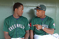 Greenville Drive manager Billy McMillon (51), right, tells starting pitcher Manuel Rivera (26) what a good job he did giving up just one run in six innings after he was pulled from a game against the Augusta GreenJackets on May 23, 2010, at Fluor Field at the West End in Greenville, S.C. Photo by: Tom Priddy/Four Seam Images