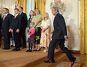 United States President George W. Bush arrives to call on Congress to pass an Iraq War spending bill with no timetable for withdrawal in the East Room of the White House in Washington, D.C. on April 16, 2007. Behind Bush are veterans and family members of service personnel.   <br /> Credit: Roger L. Wollenberg / Pool via CNP
