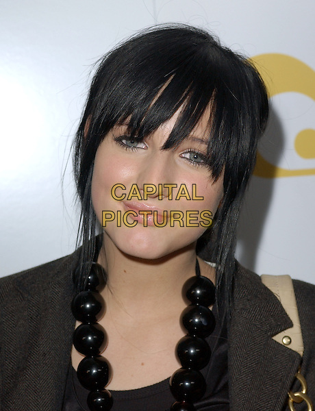 ASHLEE SIMPSON.Will.i.am Music Group and RBK's Tsunami Relief Benefit Concert held at Avalon in Hollywood, California .February 11th, 2005.headshot portrait black beaded necklace .www.capitalpictures.com.sales@capitalpictures.com.Supplied By Capital PIctures