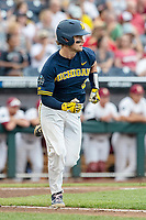 Michigan Wolverines catcher Joe Donovan (0) runs to first base during Game 6 of the NCAA College World Series against the Florida State Seminoles on June 17, 2019 at TD Ameritrade Park in Omaha, Nebraska. Michigan defeated Florida State 2-0. (Andrew Woolley/Four Seam Images)