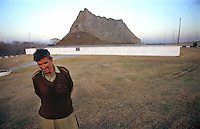 © Piers Benatar/Panos Pictures..Near Islamabad, Pakistan. 2001...Pakistan is very proud of its status as the only Muslim nuclear power, a pride which manifests itself in sculptures, murals and merchandising paraphernalia depicting its Ghauri and Shaheen missiles. Scale models of Chagain Mountain, the site of the first underground nuclear test conducted in May 1998, have been erected across the country.