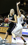 SIOUX FALLS, SD - MARCH 3:  Laura Johnson #32 from the University of Sioux Falls takes the ball to the basket against Rachel Hansen #11 from Concordia St. Paul in the second half of their semifinal game of the NSIC Tournament Monday night at the Sanford Pentagon. (Photo by Dave Eggen/Inertia)