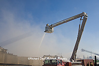 63818-02301 Firefighters extinguishing warehouse fire using aerial ladder truck, Salem, IL
