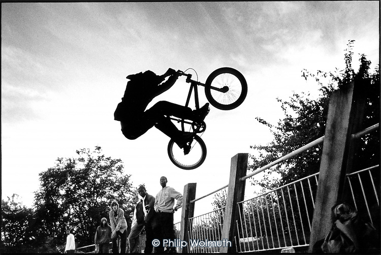 A young biker flies through the air at Meanwhile Gardens skateboard bowl in West London..