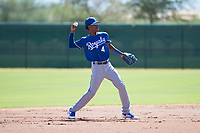 Kansas City Royals shortstop Maikel Garcia (4) throws to first base during an Instructional League game against the Chicago White Sox at Camelback Ranch on September 25, 2018 in Glendale, Arizona. (Zachary Lucy/Four Seam Images)