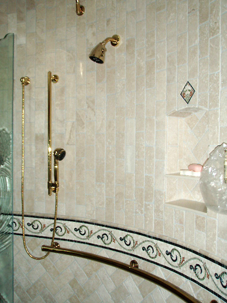 "Custom stone mosaic bath shown designed with a 5 3/4"" Gadfly border, a 5 3/8"" Cape Charles border, Basketweave field, and 3"" x 6"" Bricks in both a Runningbond and Herringbone filelds. - photo courtesy of Paula Kersten Design CID, Inc"