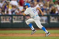 UCLA Bruin outfielder Brian Carroll (24) runs to third base during Game 4 of the 2013 Men's College World Series against the LSU Tigers on June 16, 2013 at TD Ameritrade Park in Omaha, Nebraska. UCLA defeated LSU 2-1. (Andrew Woolley/Four Seam Images)