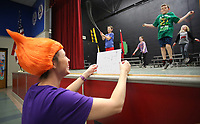 NWA Democrat-Gazette/DAVID GOTTSCHALK  Staci Selmon, physical education teacher at Vandergriff Elementary School, holds cue cards in costume Friday, March 16, 2018, for James Nolen, a fourth grade student, and others as they demonstrate a variety of rope jumping during the school's Jump Rope For Heart Celebration at the school in Fayetteville. The school raised more than $13,800 through the American Heart Association program aimed at instilling healthy eating and exercise habits in youth.