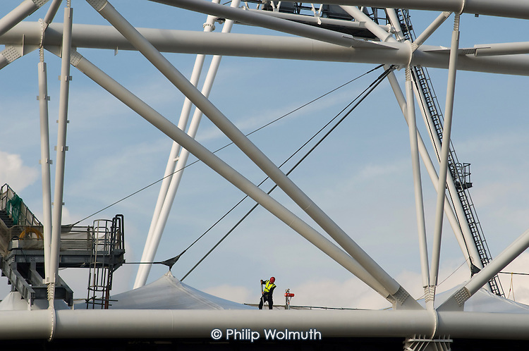 Construction worker on the roof of the London 2012 Olympic Stadium, Stratford.