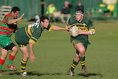 M. Hallsell takes the pass from B. Farrell. Counties Manukau Premier Club Rugby, Pukekohe v Waiuku  played at the Colin Lawrie field, on the 3rd of 2006.Pukekohe won 36 - 14