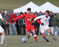St. Lawrence forward/midfielder Noah Bunton (3) dribbles as Amherst midfielder Max Fikke (15) defends. NCAA Division III Sectionals. In double-overtime, Amherst College (white) defeated St. Lawrence University (red), 2-1, on Hitchcock Field at Amherst College on November 23, 2013.