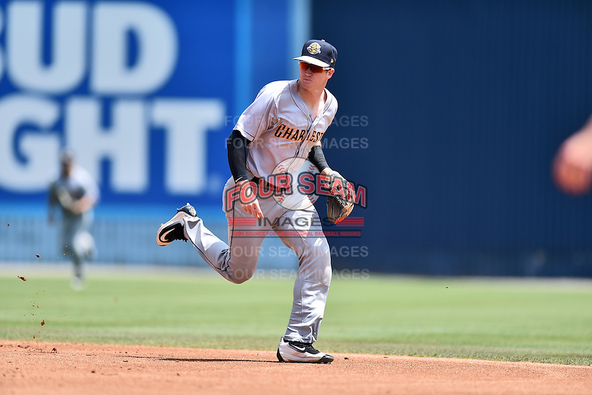 Charleston RiverDogs second baseman Kyle Holder (4) reacts to the ball during a game against the Asheville Tourists at McCormick Field on July 10, 2016 in Asheville, North Carolina. The Tourists defeated the RiverDogs 4-2. (Tony Farlow/Four Seam Images)