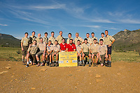 Photo story of Philmont Scout Ranch in Cimarron, New Mexico, taken during a Boy Scout Troop backpack trip in the summer of 2013. Photo is part of a comprehensive picture package which shows in-depth photography of a BSA Ventures crew on a trek. In this photo, two BSA Venture crews pose for a photo together before departing base camp for the backcountry that afternoon at Philmont Scout Ranch,  in Cimarron, New Mexico.<br /> <br /> Photo by travel photograph: PatrickschneiderPhoto.com
