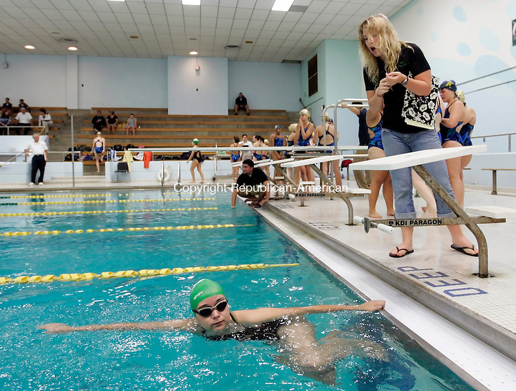 Waterbury, CT- 05, September 2011-092911CM02  Heather Thomas, Wilby High School girls swim coach, instructs sophomore Stephanie Cruz-Rincon on her race starts during their meet against Kennedy Thursday afternoon at Wilby High School in Waterbury.  It's been over 25 years since the girls had a swim team.  Christopher Massa Republican-American
