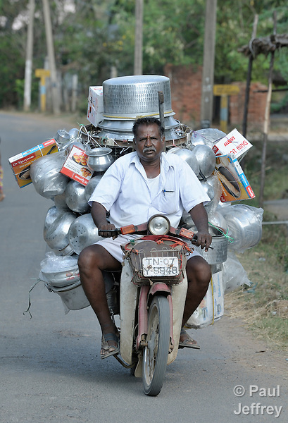 This man sells pots and pans from his motorcycle in the rural village of Irula in southern India's state of Tamil Nadu.