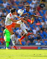 Jamal Lowe of Portsmouth and Dan Potts of Luton Town vie for the ball during Portsmouth vs Luton Town, Sky Bet EFL League 1 Football at Fratton Park on 4th August 2018