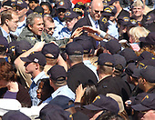 """Naval Station Mayport, Jacksonville, Fla. (Feb. 13, 2002) -- President George W. Bush shakes hands with Sailors and their families, during a visit to the Naval Station. President Bush thanked them for their sacrifices and the continuing effort with the global war on terror.  """"The United States Navy carries the might and the mission of America to the farthest parts of the world,"""" the President said.  <br /> Credit: US Navy via CNP"""