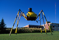 VW Volkswagen recycled for reuse as Giant Yellow Beetle Statue Roadside Attraction, Kenora, ON, Ontario, Canada