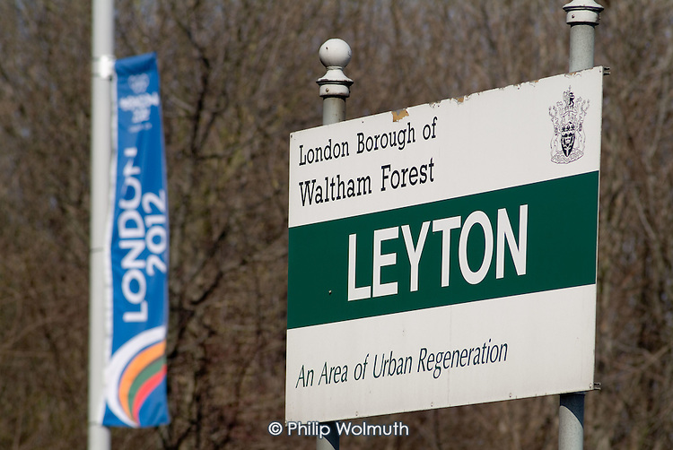 Sign marking entry to Leyton in the London Borough of Waltham Forest and a flag publicising the council's backing for London's bid for the 2012 Olympic Games.