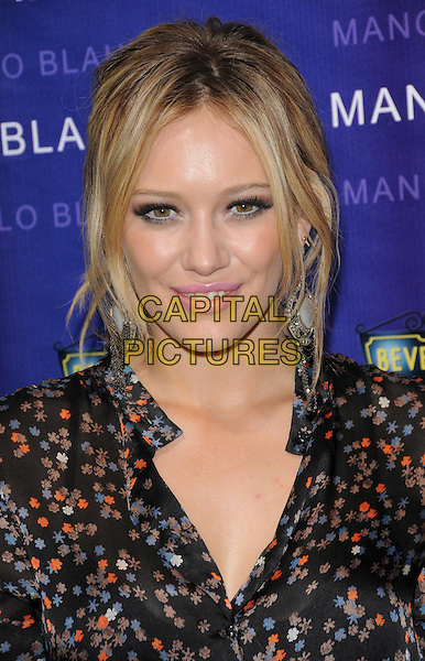 HILARY DUFF .The Rodeo Drive Walk of Style Awards Honoring Manolo Blahnik in Beverly Hills, California, USA. .September 25th, 2008.headshot portrait black skirt blouse silk satin pattern floral print           .CAP/DVS.©Debbie VanStory/Capital Pictures.