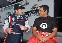 Drivers Patrick Dempsey, left, and Juan Pablo Montoya tak during a photo shoot leading up to this weekend's Rolex 24 at Daytona, Daytona International Speedway, Daytona Beach, FL January 29, 2010.  (Photo by Brian Cleary/www.bcpix.com)