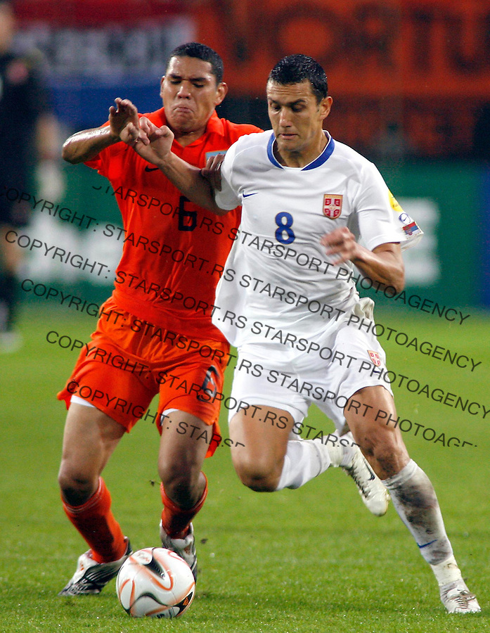 Serbia's Bosko Jankovic, right and Hedwiges Maduro, left of The Netherlands battle for the ball during their UEFA U21 Championship final soccer match between The Netherlands and Serbia at the Euroborg stadium in Groningen, The Netherlands, Saturday June 23, 2007. Srdjan Stevanovic/starsportphoto.com)