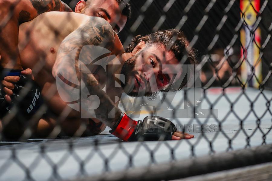 NOVA YORK, EUA, 02.11.2019 - UFC-NOVA YORK - Shane Burgos (vermelho) e Makwan Amirkhani (azul) durante UFC 244 no Madison Square Garden na cidade de Nova York neste sábado, 02. (Foto: Vanessa Carvalho/Brazil Photo Press/Folhapress)