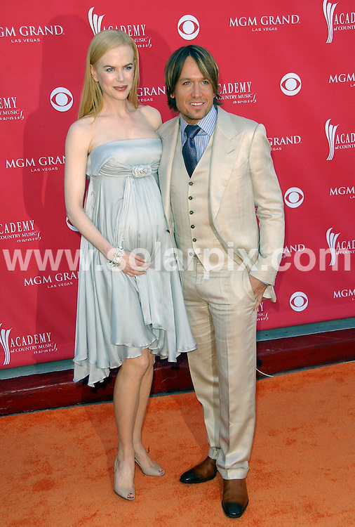 **ALL ROUND PICTURES FROM SOLARPIX.COM**.**SYNDICATION RIGHTS FOR UK, SPAIN, PORTUGAL, AUSTRALIA, S.AFRICA & DUBAI (U.A.E) ONLY**.Nicole Kidman and Keith Urban arrive at the 43rd Academy Of Country Music Awards  held at the MGM Grand Garden Arena, Las Vegas, NV, USA 18th May 2008..This pic: Nicole Kidman and Keith Urban..JOB REF: 6448 PHZ/Albert L. Ortega.DATE: 18_05_2008.**MUST CREDIT SOLARPIX.COM OR DOUBLE FEE WILL BE CHARGED* *UNDER NO CIRCUMSTANCES IS THIS IMAGE TO BE REPRODUCED FOR ANY ONLINE EDITION WITHOUT PRIOR PERMISSION*