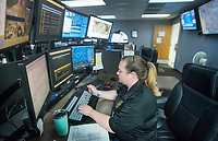 NWA Democrat-Gazette/BEN GOFF @NWABENGOFF<br /> Lacy Sprinkles dispatches calls for the Springdale Fire Department Thursday, Sept. 6, 2018, in the dispatch room at the Springdale Police Department.