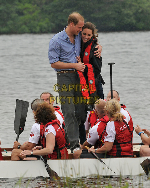 The Duke and Duchess of Cambridge.Royal Tour of Canada. Prince Edward Island, Canada 4th July 2011.canoe cuddling.CAP/CAS.©Bob Cass/Capital Pictures.