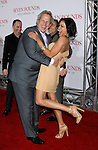 """WESTWOOD, CA. - December 16: Producer Steve Tisch and Actress Rosario Dawson arrive at the Los Angeles premiere of """"Seven Pounds"""" at Mann's Village Theater on December 16, 2008 in Los Angeles, California."""